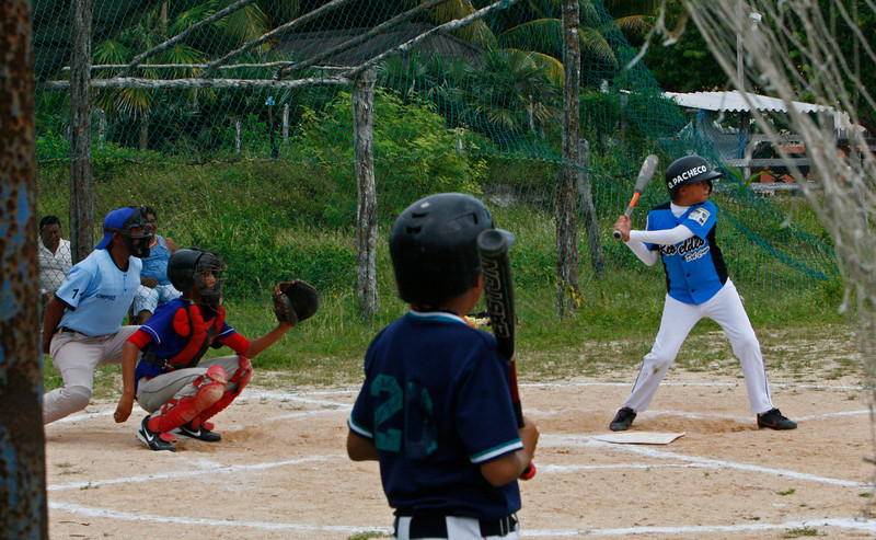 We watch a bunch of junior high kids play a baseball game in El Cuyo.