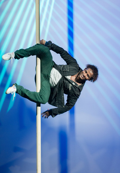A a one man show in the Celebrity Constellation theater doing juggling and pole stunts.