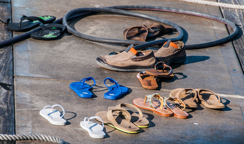 Trusting people who left their shoes on the dock while they off on doing some water-jet skiing.