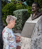 Key West Historic Memorial Sculpture Garden - Judy Sanders reading about Ernest Hemingway