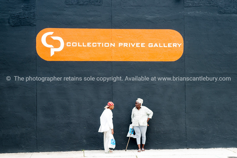 """Gallery wall, with two black women. <br /> Wynwood, Miami, street art, graffiti in the """"Art Walk"""" and old wahehouse district. Prints and downloads."""