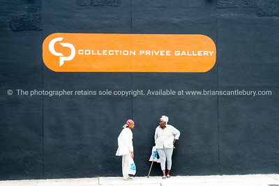 "Gallery wall, with two black women.  Wynwood, Miami, street art, graffiti in the ""Art Walk"" and old wahehouse district. Prints and downloads."