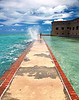 The sea wall of Fort Jefferson gets battered by the ocean waves and we got splashed on as we walked past.