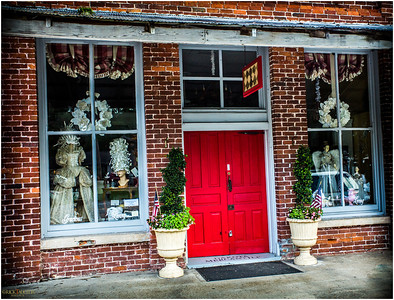 Dakota Mercantile Gracious Living's lipstick red door.