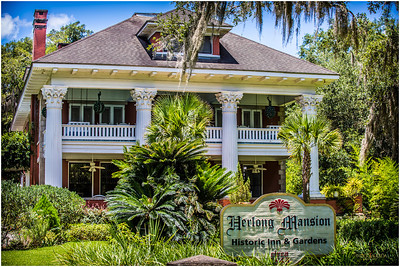 "The Herlong Mansion was originally a simple ""cracker style"" pine farm home built circa 1845.  It was a two-story affair with a detached kitchen built by the Simonton family, one of the original settlers of Micanopy."