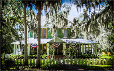 Typical southern Florida home with wrap around porch and tin roof at the end of a main street.