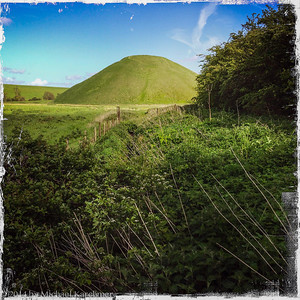 Silbury Hill, the largest man-made mound in Europe, associated with Avebury and Stonehenge; thought to be over 4,500 years old; purpose not entirely understood (May, 2014)