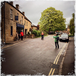 Bourton-on-the-Water: Suz taking Japanese tourists' photo with their own camera (May, 2014)