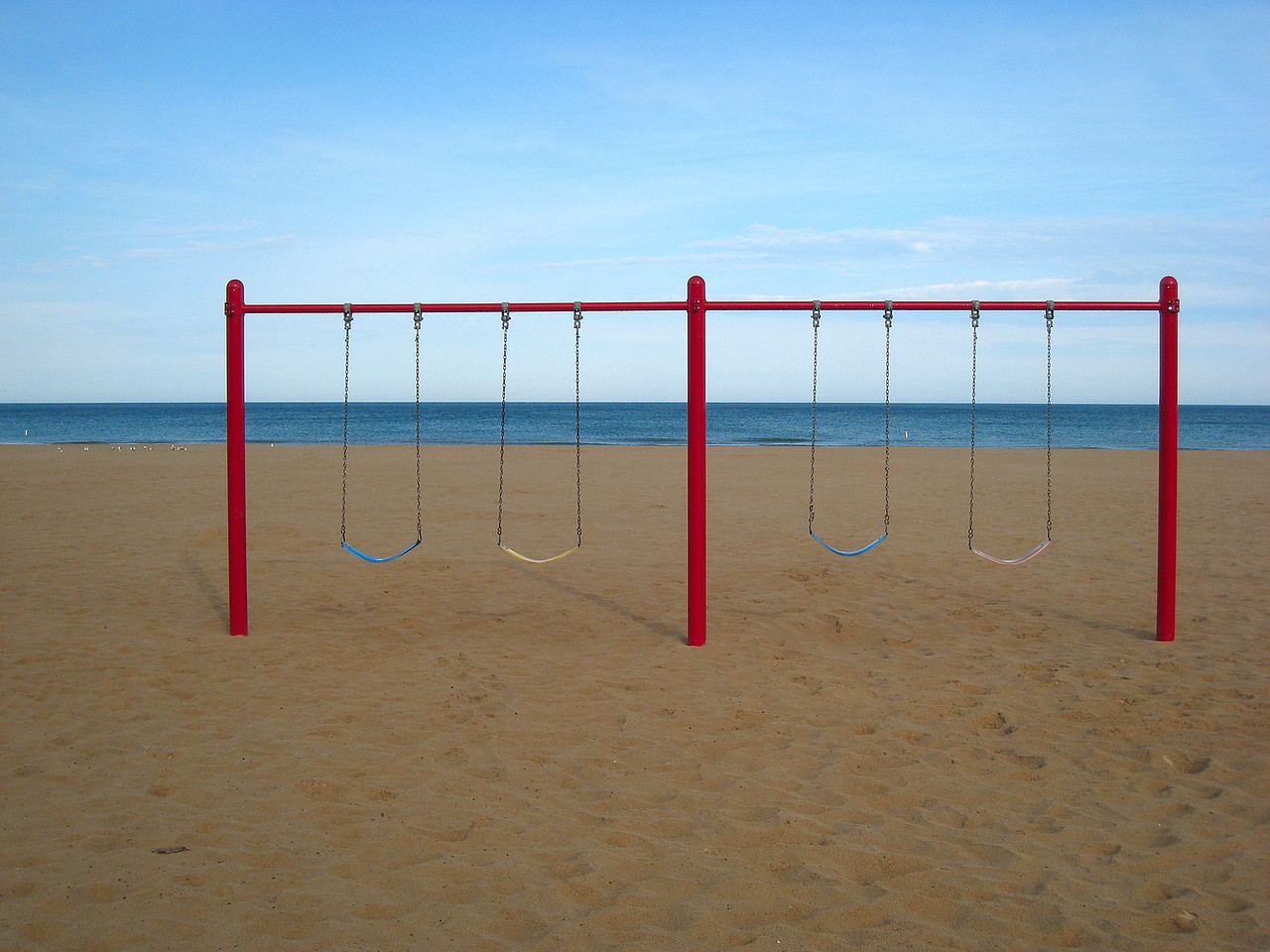 The swingset at the beach in South Haven Michigan in the early morning.