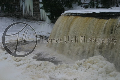 Those icicles in the background get up to forty feet long! Taquamon Falls, Michigan.