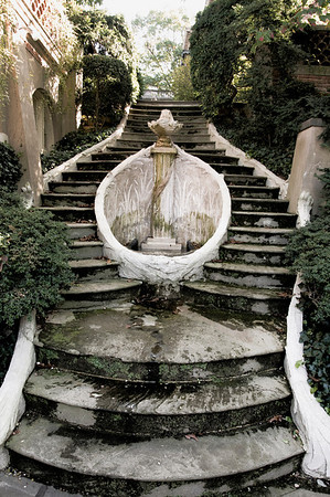 the staircase surrounding the Horseshoe Fountain leading down to the private pool.