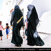 Middle East - GCC - Bahrain - Muharraq Town - Old capital of Bahrain - Traditional Bahraini architecture - Women wearing abaya - Traditional arabic dress
