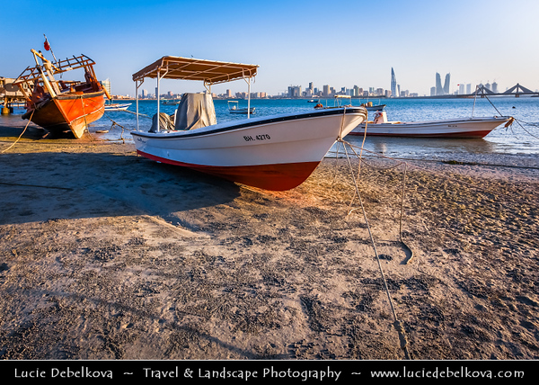 Middle East - GCC - Bahrain - Modern Manama City Skyline from traditional Muharraq area - Beach area with boats and dhows