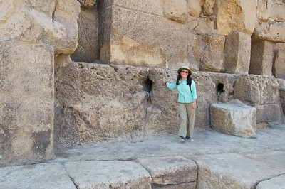 At the base of the Great Pyramid, Sheri poses to give the stones some scale.