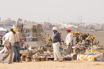 Hawkers sell trinkets all around the plateau