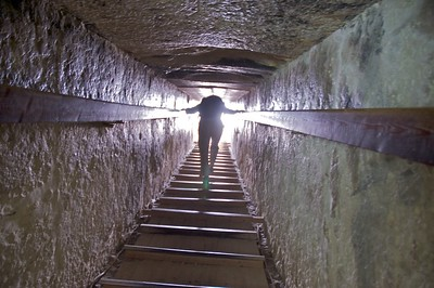 Climbing out of the pyramid while hunched over, sweaty and hot. Despite being underground, it must have been 100° inside the tomb.