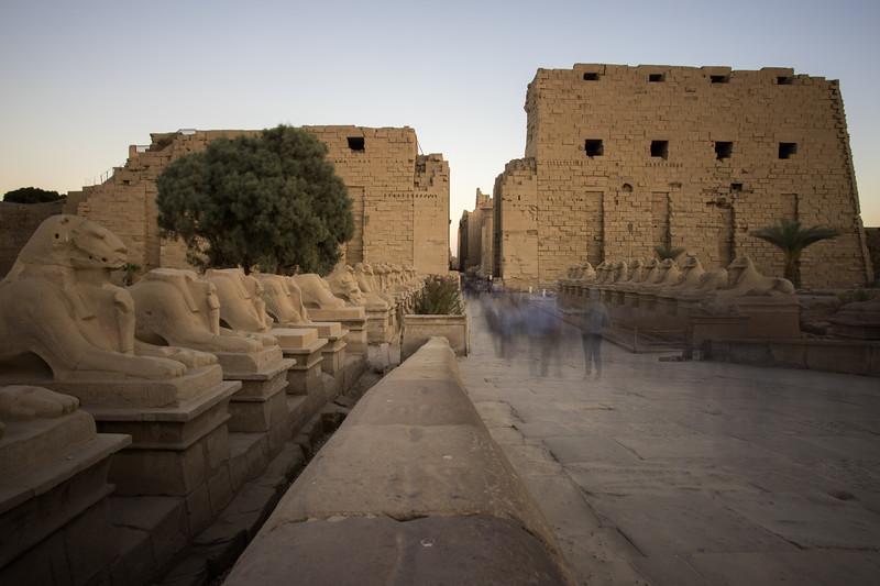 Tourists stream through the entrance to Karnak Temple near Luxor, Egypt.