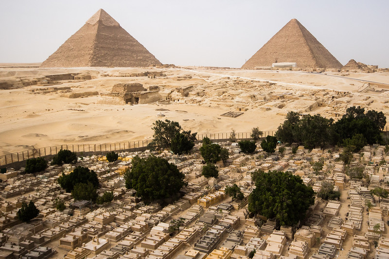 The Great Pyramids at Giza with a local cemetery in the foreground.