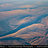 Middle East - Iran - Fars Province - Zagros Mountains - Largest mountain range in Iran - Impressive landscape of long linear ridges and valleys formed by collision of Eurasian and Arabian tectonic plates - Aerial View during late afternoon warm light