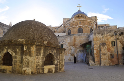 A wide-angle lens and close proximity distort the perspective of the roof top of the Church of the Holy Sepulchre. The dark figure near the middle is an Ethiopian priest.