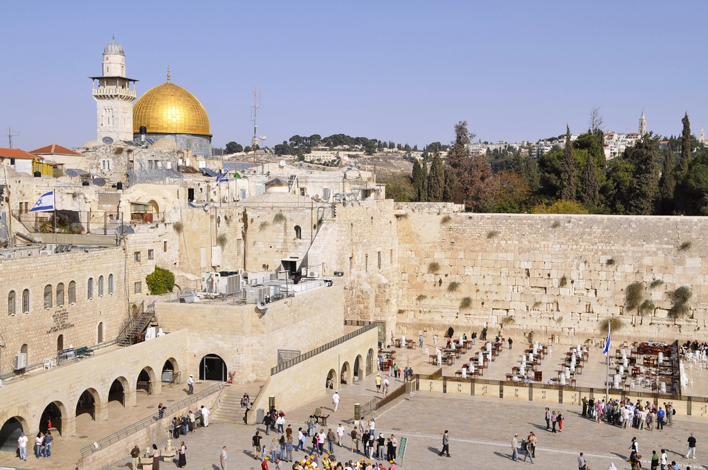 The golden Dome of the Rocks share a wall with the Western Wall.
