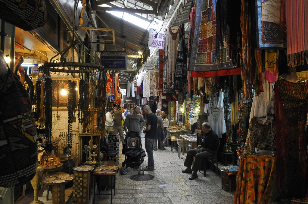Light barely enters the tightly packed marketplace selling mainly to tourists in Jerusalem.