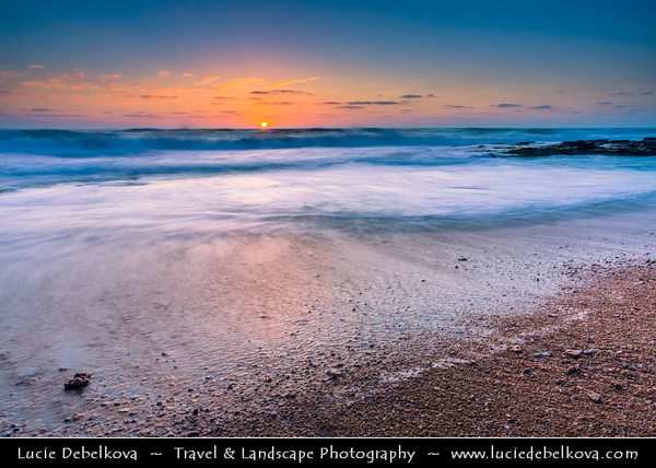 Israel - Tel Aviv - תֵּל־אָבִיב - City located on Israeli shores of the Mediterranean Sea coastline in central-west Israel - City surrounding beaches at Sunset