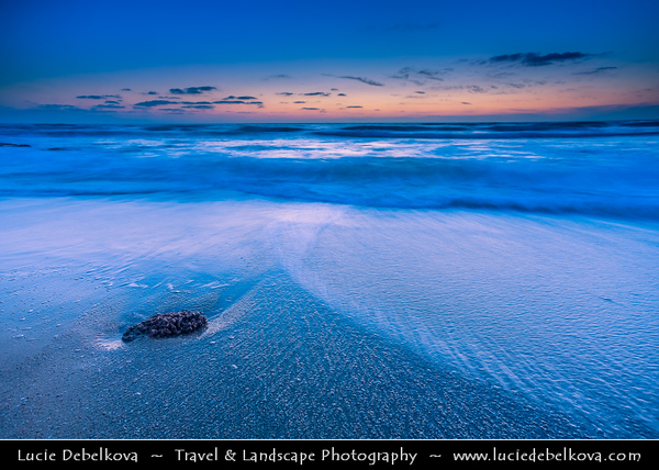 Israel - Tel Aviv - תֵּל־אָבִיב - City located on Israeli shores of the Mediterranean Sea coastline in central-west Israel - City surrounding beaches at Sunset