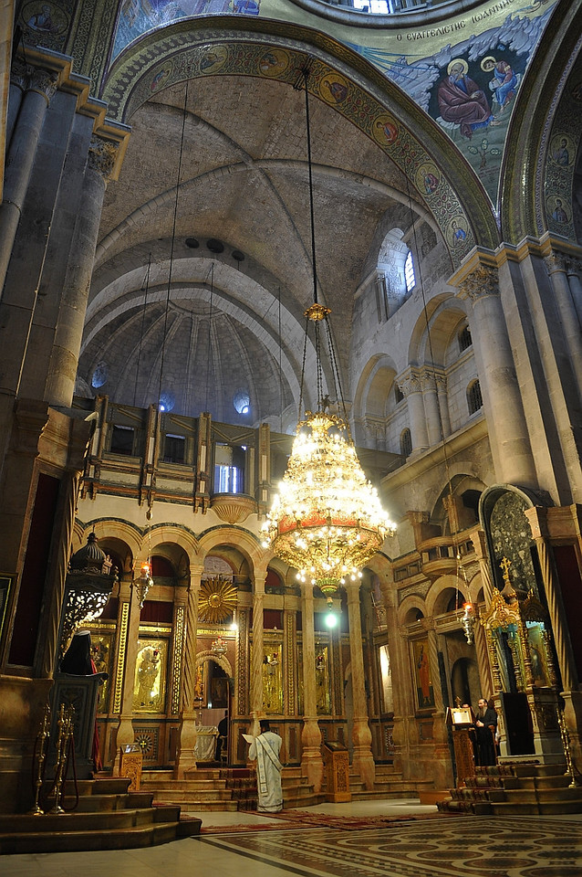A service is in session at the Church of the Holy Sepulchre.