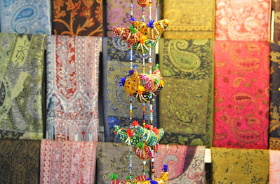 Knickknacks hang in front of colorful fabric in old Jerusalem.