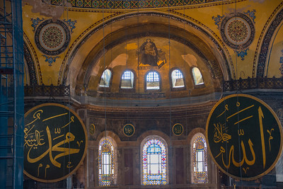 A unique display of both Christian and Muslim symbols inside the Hagia Sofia attesting to its history as both a cathedral and a mosque.