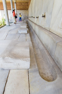 Ablutions area with marble seats with worn butt indents