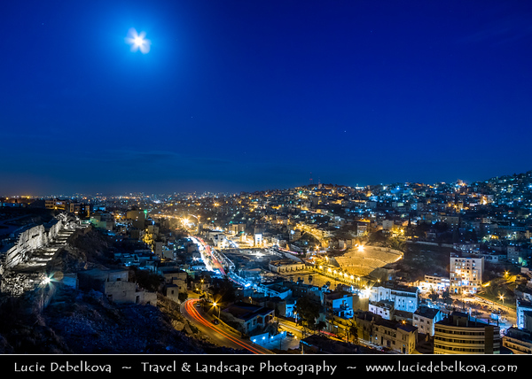 Middle East - Jordan - Hashemite Arab Kingdom of Jordan - Amman - Capital & largest city of Jordan - One of oldest continuously inhabited cities in world - City Skyline with Ancient Roman theater - Restored Roman Theatre - Most impressive remnant of Roman Philadelphia - One of Amman's highlights