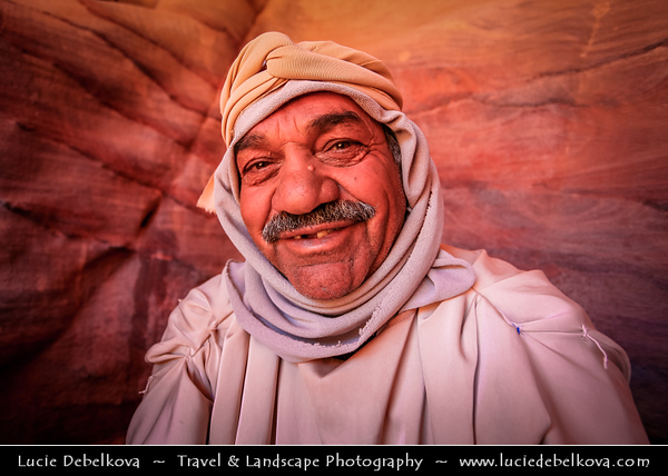 Middle East - Jordan - Hashemite Arab Kingdom of Jordan - Petra - UNESCO World Heritage Site - Rose City - World famous historical & archaeological  Nabataeans city carved from the red sandstone cliffs on the slope of Jebel al-Madhbah - Jordan's most valuable treasure and greatest tourist attraction - Local Bedouin people living their daily life in ruins of ancient city