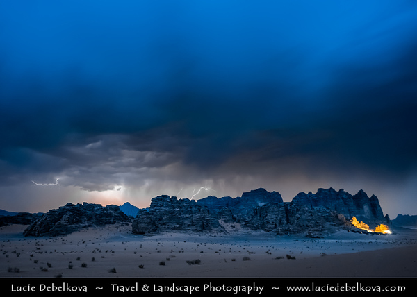 Jordan - Hashemite Arab Kingdom of Jordan - Wadi Rum - UNESCO World Heritage Site - The Valley of the Moon - Spectacularly scenic desert valley cut into the sandstone and granite rock in southern Jordan - Unusual storm with lightning