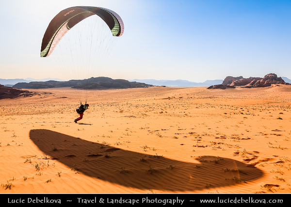 Jordan - Hashemite Arab Kingdom of Jordan - Wadi Rum - UNESCO World Heritage Site - The Valley of the Moon - Spectacularly scenic desert valley cut into the sandstone and granite rock in southern Jordan - Paragliding in stunning desert area