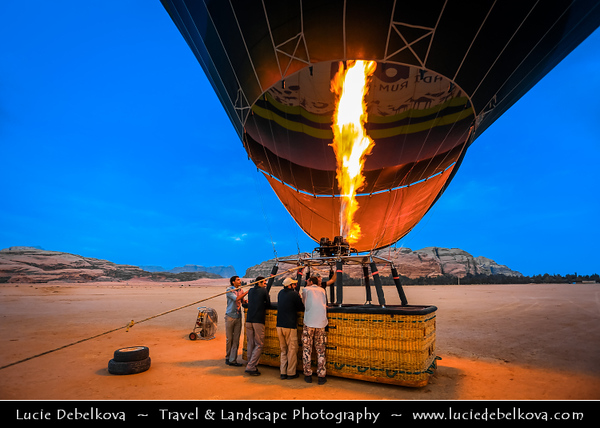 Jordan - Hashemite Arab Kingdom of Jordan - Wadi Rum - UNESCO World Heritage Site - The Valley of the Moon - Spectacularly scenic desert valley cut into the sandstone and granite rock in southern Jordan - Preparing for balloon flight