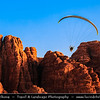 Jordan - Hashemite Arab Kingdom of Jordan - Wadi Rum - UNESCO World Heritage Site - The Valley of the Moon - Spectacularly scenic desert valley cut into the sandstone and granite rock in southern Jordan - Man and ring of fire - Circle of Sparkle