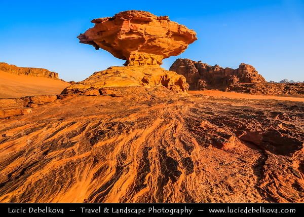 Jordan - Hashemite Arab Kingdom of Jordan - Wadi Rum - UNESCO World Heritage Site - The Valley of the Moon - Spectacularly scenic desert valley cut into the sandstone and granite rock in southern Jordan - Mushroom Rock Formation - One of the most visited places in Wadi Rum