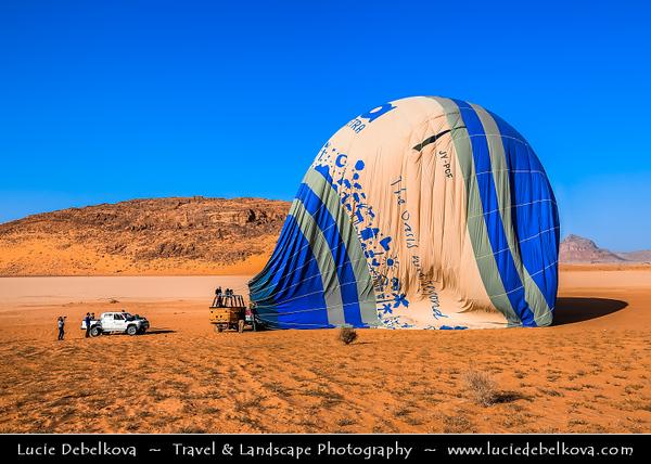 Jordan - Hashemite Arab Kingdom of Jordan - Wadi Rum - UNESCO World Heritage Site - The Valley of the Moon - Spectacularly scenic desert valley cut into the sandstone and granite rock in southern Jordan - Preparation for balloon flight