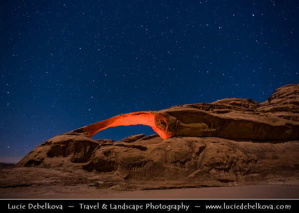 Jordan - Hashemite Arab Kingdom of Jordan - Wadi Rum - UNESCO World Heritage Site - The Valley of the Moon - Spectacularly scenic desert valley cut into the sandstone and granite rock in southern Jordan - Big Natural Arch carved by nature forces - Night