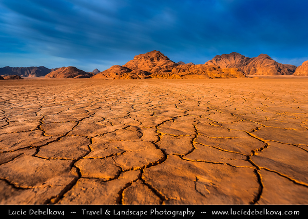 Jordan - Hashemite Arab Kingdom of Jordan - Wadi Rum - UNESCO World Heritage Site - The Valley of the Moon - Spectacularly scenic desert valley cut into the sandstone and granite rock in southern Jordan - Early morning light over stunning desert landscape