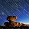 Jordan - Hashemite Arab Kingdom of Jordan - Wadi Rum - UNESCO World Heritage Site - The Valley of the Moon - Spectacularly scenic desert valley cut into the sandstone and granite rock in southern Jordan - Startrails over desert landscape