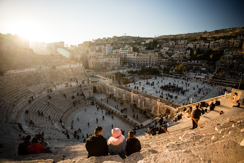 A local family watches sunset from the Roman Theater coliseum in Amman, Jordan.