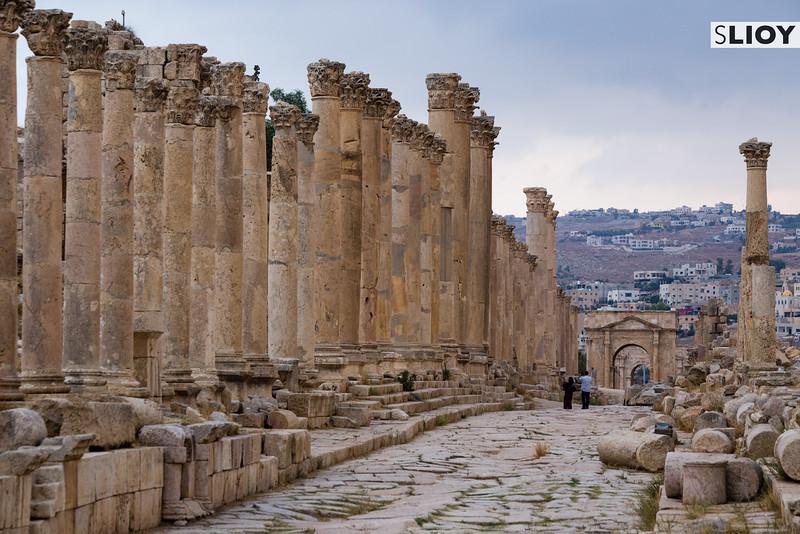 Tourists walking along the Cardo Maximum inside the ruins of ancient Jerash in Northern Jordan.
