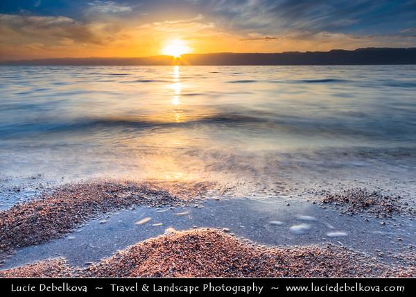 Middle East - Jordan - Hashemite Arab Kingdom of Jordan - Aqaba - Aqabah - Jordanian coastal city situated at the northeastern tip of the Red Sea - Sunset on city beach