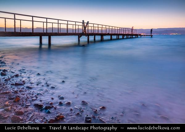 Jordan - Hashemite Arab Kingdom of Jordan - Aqaba - Aqabah - Jordanian coastal city situated at the northeastern tip of the Red Sea - Dusk on the city beach