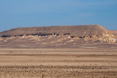Note sand dunes against hillside
