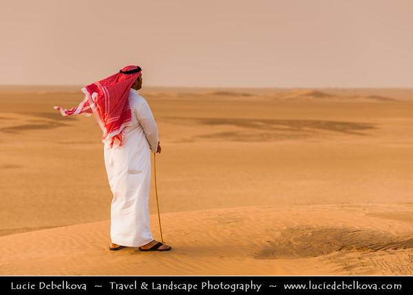 Middle East - GCC - Kuwait - Kuwaiti Desert - Sea of Sand Dunes and Man in Traditional Arabic Dress - Dishdasha
