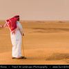 Middle East - GCC - Kuwait - Kuwaiti Desert - Sea of Sand Dunes and Man in Traditional Arabic Dress - Dishdasha